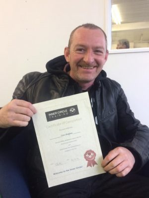 """Cory with is """"DAS course completion"""" certificate after passing his motorcycle test"""